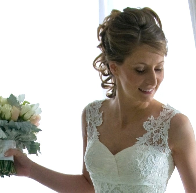 Elegant swirls and curls of bridal hair and makeup